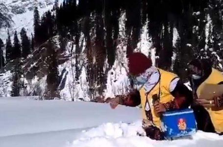 Polio workers walk in waist-deep snow to vaccinate children